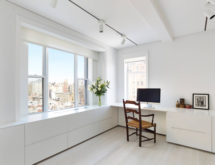 Minimalist Home Office Inspiration White Workspace With White Walls Light Hardwood Floors And A Built In Desk