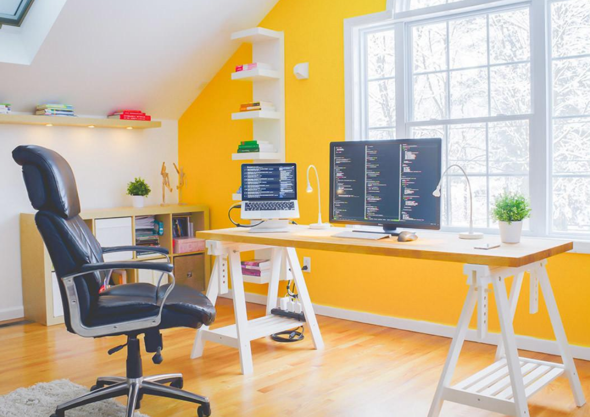 home office with yellow accents wall decor